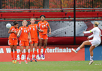 COLLEGE PARK, MD - OCTOBER 28, 2012:  Olivia Wagner (11) of the University of Maryland sends a free kick past Jasmine Paterson (15) Ali Brennan (23), Ashley Flinn (5) and Blake Stockton (29).of Miami during an ACC  women's tournament 1st. round match at Ludwig Field in College Park, MD. on October 28. Maryland won 2-1 on a golden goal in extra time.