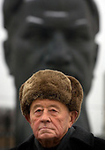 "Portrait of Pavel Egorenkov, head of laboratory at the Kurchatov Institute in Moscow..Egorenkov, in his 80s, is considered ""The grandfather of Russian nuclear reactors"", as he had a hand in designing them. .Egorenkov is standing in front of a statue of Igor Vasilyevich Kurchatov (1903 ñ  1960), the leader of the Soviet atomic bomb project."