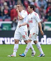 FUSSBALL   1. BUNDESLIGA  SAISON 2011/2012   34. Spieltag 1. FC Koeln - FC Bayern Muenchen        05.05.2012 Lukas Podolski (li.) mit Sascha Riether (1. FC Koeln)