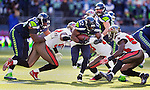 Seattle Seahawks Running back Robert Turbin runs through a hole in the Tampa Bay Buccaneers defensive line in the second quarter at CenturyLink Field in Seattle, Washington on  November 3, 2013.  The Seahawks beat the Buccaneers 27-24 in overtime. ©2013. Jim Bryant. All Rights Reserved.
