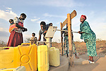 Women pump water from a well constructed by the United Methodist Committee on Relief (UMCOR) in the Southern Sudanese town of Yei.
