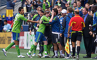 Seattle Sounders FC midfielder Erik Friberg  center celebrates scoring a goal with teammates including Seattle Sounders FC \d12\ during play against and the New York Red Bulls at Qwest Field in Seattle Saturday June 23, 2011. The Sounders won the game 4-2.
