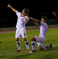 Andrew Oliver (16) of the United States celebrates his goal with teammate Alejandro Guido (10) during the semifinals of the CONCACAF Men's Under 17 Championship at Catherine Hall Stadium in Montego Bay, Jamaica. The United States defeated Jamaica, 2-0.