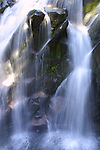 Waterfall on Mount Rainier.  Mt. Rainier is heavily glaciated, dormant volcano surrounded by alpine parks. The 14,411 foot volcano which covers 228,480 acres was designated a National Park in 1899. Jim Bryant Photo. ©2010. All Rights Reserved.