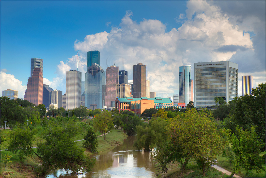 On a warm September afternoon, Houstonians get out and enjoy a relaxing stroll around the green belt that offers sweeping views ofthe Houston skyline and downtown. Featured as the tallest building in Houston, the JP Morgan Chase Tower rises 75 stories above the waterfront. <br /> <br /> This little section of Buffalo Bayou provides miles of biking and walking trails, and I even saw some canoers in the waters below me.