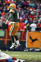 Brett Favre leaps to see if his pass was complete in the 1996 game against the Denver Broncos.