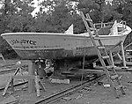 Famed boatbuilder Mildon Willis of Marshallberg built the Clara Joyce in 1946 for Earl C. Wade of Williston.  The boat was made with cypress, juniper and heart pine.  Her bow is flared, like the bows made by Harkers Island boatbuilder Brady Lewis.  She was named after Wade's daughters Joyce Wade Mason of Atlantic and Clara Wade Lewis of Marshallberg.  Subsequently, Earl Chadwick of Marshallberg used her to fish for shrimp, clams and oysters.  The boat was photographed at the marine railway in Gloucester where Lloyd Piggott was rebuilding her for Temple Chadwick, Earl Chadwick's son.