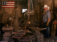 Photo by Gary Cosby Jr.  ..A blacksmith works in his stop in Tombstone, AZ at the site of the legendary gunfight in the OK Corral.