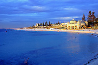 Legs is a view of Cottesloe Beach from the groyne with a woman doing an underwater hand stand in the corner.