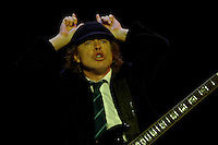 Angus Young of Australian rock band AC/DC gestures to the crowd during a concert on their Black Ice tour, Friday, Jan. 9, 2009, at the Rogers Centre in Toronto. (Arthur Mola/pressphotointl.com)