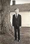 1968. Young mature boy dressed in suit and tie for wedding. Wedding ring bearer.