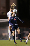 16 November 2012: UNC's Kelly McFarlane (behind) heads the ball over Illinois' Nicole Breece (below). The University of North Carolina Tar Heels played the University of Illinois Fighting Illini at Fetzer Field in Chapel Hill, North Carolina in a 2012 NCAA Division I Women's Soccer Tournament Second Round game. UNC won the game 9-2.