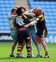 The Wasps and Northampton Saints front rows get to know each other off the ball. Aviva Premiership match, between Wasps and Northampton Saints on April 3, 2016 at the Ricoh Arena in Coventry, England. Photo by: Patrick Khachfe / JMP