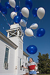 Young D.J. chases balloons at his grandfather's wedding.