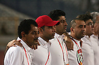 United Arab Emirates' Head Coach Mahdi Redha, second from left, and his coaching staff stand together for the playing of the national anthem before the match against Cost Rica during the FIFA Under 20 World Cup Quarter-final match at the Cairo International Stadium in Cairo, Egypt, on October 10, 2009. Costa Rica won the match 1-2 in overtime play.