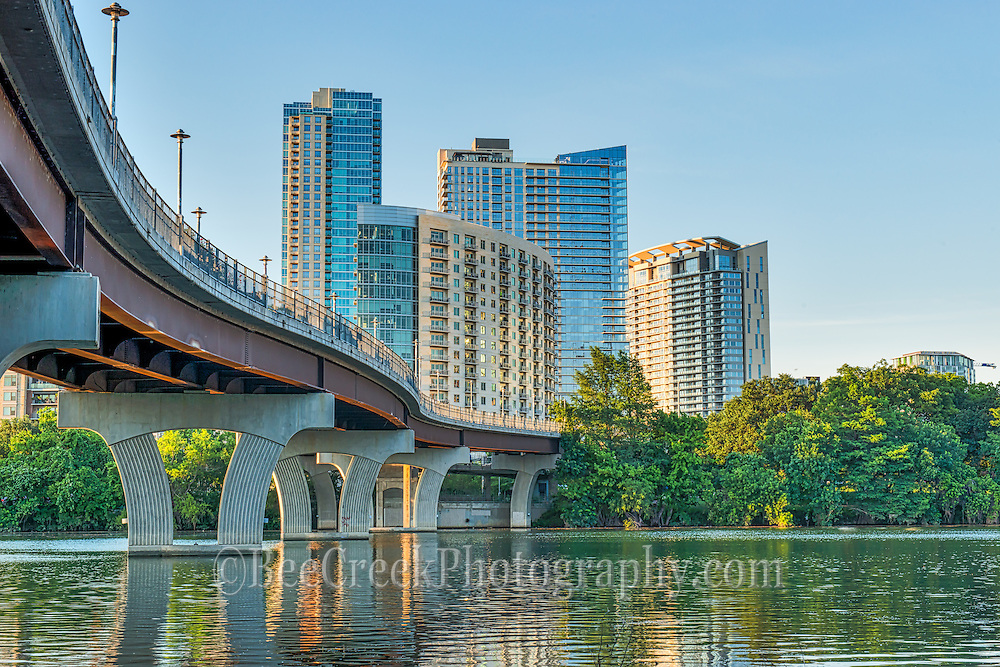 We capture this image of  Pfluger Bridge on Ladybird Lake with the high-rise condos in the background. We took this from below the pedestrian bridge and notice all the people hanging out underneath it. Kayaks and canoes seem to just be sitting under the shade of the bridge, some were jumping into the water, some appeared to be having a picnic.