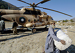 Following an October 8, 2005, earthquake in northern Pakistan, Church World Service/Action by Churches Together responded quickly to the needs of thousands of affected families. Here a Pakistan Army helicopter is used to ferry relief supplies provided by CWS/ACT.