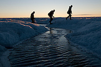 Scientists exploring the Greenland ice cap under the midnight sun.