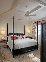Asian antiques and Balinese Batik fabrics in a  unique guest bedroom