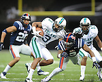 Ole Miss defensive back Charles Sawyer (3) hits Tulane's Ryan Garrett (3) in the first half at the Mercedes-Benz Superdone in New Orleans, La. on Saturday, September 22, 2012. Ole Miss won 39-0...