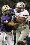 "Carl Winston (#32), Washington State running back and kick returner, is brought down by the UW's Joshua Gage (#24) during the Cougars Pac-10 conference ""Apple Cup"" showdown with arch-rival Washington at Husky Stadium in Seattle, Washington, on November 28, 2009.  The Cougars lost to the Huskies in the game, 30-0."
