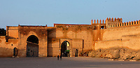 General view of the walls of Bou Jeloud Square, 14th century, Fes-el-Bali, Fez, Morocco, pictured on February 25, 2009 in the warm morning light. Fez, Morocco's second largest city, and one of the four imperial cities, was founded in 789 by Idris I on the banks of the River Fez. The oldest university in the world is here and the city is still the Moroccan cultural and spiritual centre. Fez has three sectors: the oldest part, the walled city of Fes-el-Bali, houses Morocco's largest medina and is a UNESCO World Heritage Site;  Fes-el-Jedid was founded in 1244 as a new capital by the Merenid dynasty, and contains the Mellah, or Jewish quarter; Ville Nouvelle was built by the French who took over most of Morocco in 1912 and transferred the capital to Rabat. Picture by Manuel Cohen.