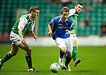 Hibs v St Johnstone...28.09.11   SPL Week.Chris Millar evades Ian Murray and Ivan Sproule.Picture by Graeme Hart..Copyright Perthshire Picture Agency.Tel: 01738 623350  Mobile: 07990 594431