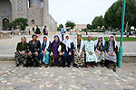 Uzbek women sitting on a bench in front of the Samarkand Mosque, on a Sunday afternoon