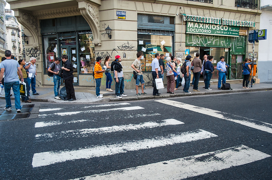 BUENOS AIRES - CIRCA NOVEMBER 2012: Locals waiting the bus in the San Telmo neighborhood, Circa November 2012. The city is a very popular tourist destination with over 2.5 million yearly visitors.