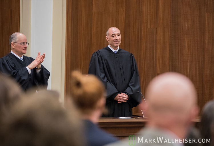 Florida Supreme Court Justice Charles Canady, left, applauds during the investiture of the Honorable Alan Lawson when he takes his seat as the 86th Justice of The Supreme Court of Florida in Tallahassee, Florida