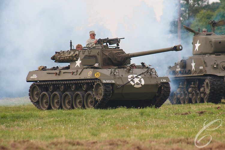 """Reenactors showcase World War II tanks, half-tracks and support vehicles during the Museum of the America G.I.'s annual Open House on March 29, 2008 in College Station, Texas. This vehicle is a M18 """"Hellcat"""" Tank Destroyer."""