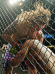 Clay Guida, top, gets tangled up with Benson Henderson against the fence during Saturday's UFC on Fox event at the Honda Center.