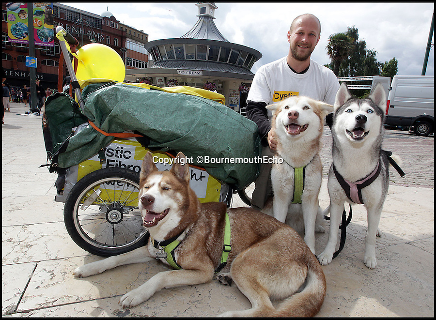 BNPS.co.uk (01202 558833)<br /> Pic: SallyAdams/BNPS<br /> <br /> ***Please Use Full Byline***<br /> <br /> <br /> Keath Armstrong arrives in Bournemouth with his three husky dogs Sakari, Nukka and Nala after travelling 318 miles from Manchester to raise money for cystic fibrosis.<br /> <br /> Barking mad...<br /> <br /> A man has moved 260 miles away and made the entire journey on foot with just his dogs to help drag his possessions.<br /> <br /> Keath Armstrong, 32, originally planned to move from Crumpsall in Manchester to Bournemouth in Dorset the conventional way, with a removal van.<br /> <br /> But he decided to walk the massive distance as a way to raise money for Cystic Fibrosis, after his friends Richard and Carl Jones died from the disease.<br /> <br /> Keath and his huskies walked between 11 and 30 miles each day and the journey took almost one month to complete.<br /> <br /> He used a three wheeled sled to carry his belongings which was pulled by the three dogs, Nala, four, Nukka, five, and Sakari, nine.<br /> <br /> Keath, who worked as a waiter in a restaurant but quit to do the challenge, camped every night along the way.<br /> <br /> He originally planned to make the trip by walking along the roads but realised it was too dangerous and opted to follow canals.<br /> <br /> He raised more than 3,100 pounds for the charity which was three times more than what he had hoped to do.
