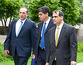 Washington, DC - May 14, 2009 -- Former F.B.I. Agent Mark Rossini, boyfriend of actress Linda Fiorentino, center, leaves U.S. District Court in Washington, D.C. with his attorney Adam Hoffinger, left, and his brother John Rossini, right, after being sentenced to a year's probation and a $5,000 fine for his role in illegally accessing F.B.I. documents..Credit: Ron Sachs / CNP .(RESTRICTION: NO New York or New Jersey Newspapers or newspapers within a 75 mile radius of New York City)