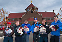 Six of the youth volunmteers display their selection of frozen turkeys from the stack of almost 300 birds collected Sunday at. St. Paul's Catholic church in Westerville. The annual  November collection donations are destined for Holy Rosary-St. John parish in downtown Columbus for its food kitchen.
