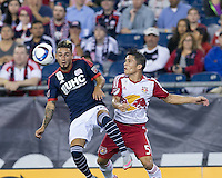 Foxborough, Massachusetts - September 16, 2015: First half action. In a Major League Soccer (MLS) match, the New England Revolution (blue/white) vs New York Red Bulls (white/red), 1-1 (halftime), at Gillette Stadium.