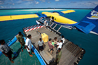 November 25th, 2008_MALDIVES_ Guests arrive by sea plane to the Soneva Fushi resort island, in the Maldives' Northern Baa Atoll .  Soneva Fushi is a leader in green practices and plans to be carbon neutral by 2010 by implementing projects such as a deep-sea water cooling system to replace it's traditional air conditioners.  Photographer: Daniel J. Groshong/Tayo Photo Group
