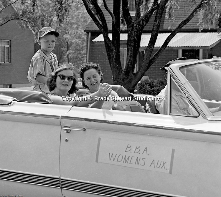 Bethel Park PA: View of members of the Bethel Baseball Association Women's Auxiliary participating in the Annual BBA Parade - 1964.  Riders include; Marge Westhoff, Marion Streiner and Craig Streiner