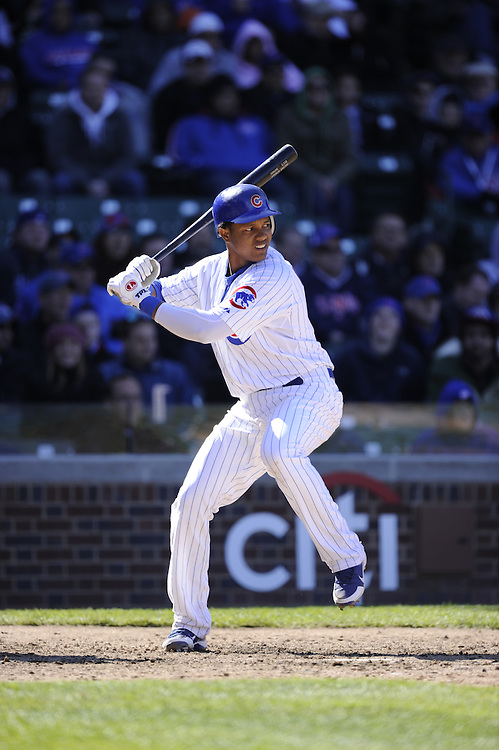 CHICAGO - APRIL  11:  Starlin Castro #13 of the Chicago Cubs bats against the Milwaukee Brewers on April 11, 2012 at Wrigley Field in Chicago, Illinois.  The Brewers defeated the Cubs 2-1.  (Photo by Ron Vesely)   Subject:  Starlin Castro