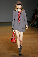 Constance Jablonski walks runway in an indigo melange roxy herringbone shorts suit, merlot multi disco satin blouse, merlot voyage satchel, and black patent lace up oxfords, from the Marc by Marc Jacobs Fall/Winter 2011 collection, during New York Fashion Week, Fall 2011.
