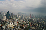 View of Tokyo and Tokyo Tower, as seen from the Mori Tower in Roppongi Hills. Tokyo, Japan. Mori Tower houses the Mori Arts Museum and the 52nd floor Tokyo View observation deck.
