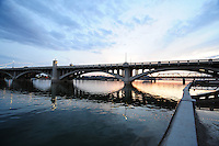 Tempe, Arizona. A southwestern view of Tempe Town Lake at sunset shows a Mill Avenue bridge in the foreground and the Light Rail bridge in the foreground. Photo by Eduardo Barraza © 2015