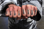 "Jeff was ""Hell Bent"" in showing off his tattoos on his fingers while hanging out in the Tenderloin district of San Francisco, California."