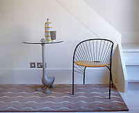 Subtle tones of mauve, blue and mimosa in this modern rug at the foot of an open staircase