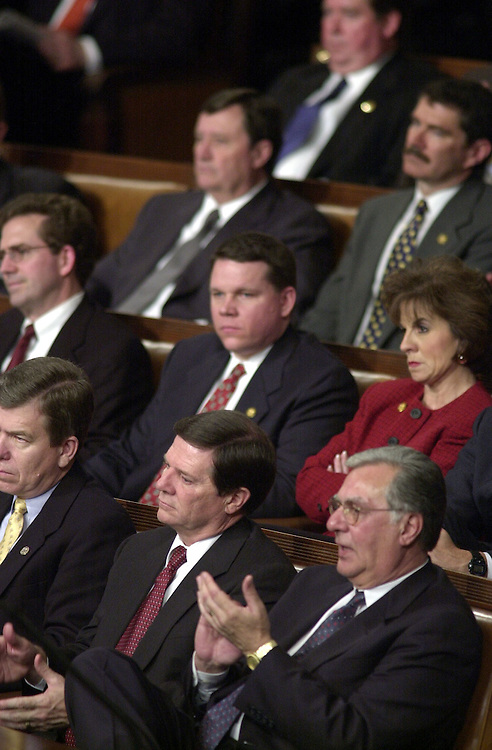 10joint022701 --Republican members of Congress listen to the President during his address to the Joint Session of Congress.