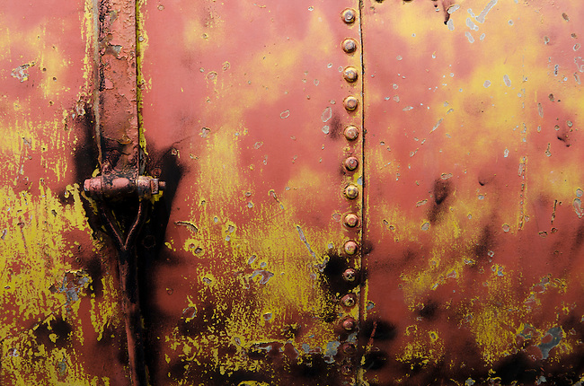 Orange and Yellow rusty metal tank
