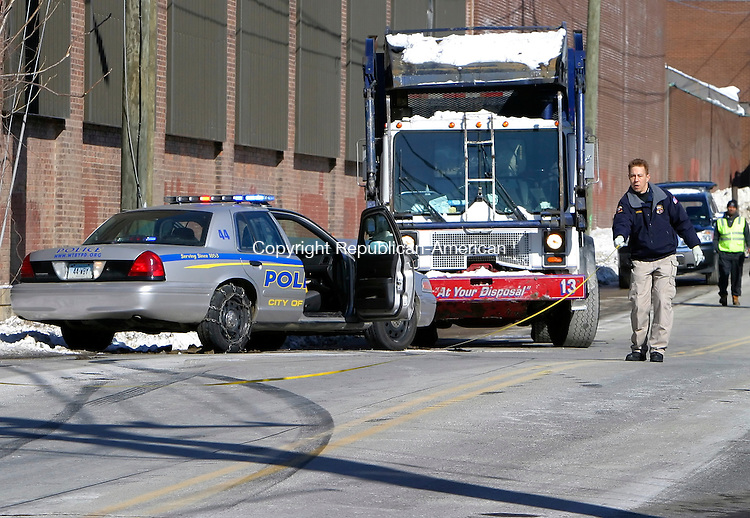 WATERBURY, CT. 04 March 2009-030409SV01--Police crime scene officers investigate a police cruiser that collided with a garbage truck on South Main Street near Washington Ave. in Waterbury Wednesday.<br /> Steven Valenti Republican-American