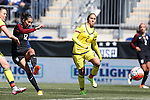 10 April 2016: Christen Press (USA) (12) shoots past Carolina Arbelaez (COL) (2). The United States Women's National Team played the Colombia Women's National Team at Talen Energy Stadium in Chester, Pennsylvania in an women's international friendly soccer game. The U.S. won the match 3-0.