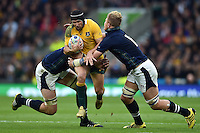 Matt Giteau of Australia takes on the Scotland defence. Rugby World Cup Quarter Final between Australia and Scotland on October 18, 2015 at Twickenham Stadium in London, England. Photo by: Patrick Khachfe / Onside Images