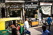 Pedestrians walk past rows of jewellery stores in Dariba Kalan, Old Delhi, India. Photo: Sanjit Das/Panos Pictures